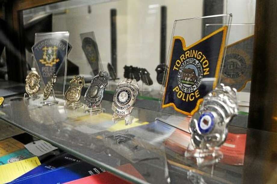 Jessica Glenza-Register Citizen - Shields of the Torrington Police Department on display in the station.