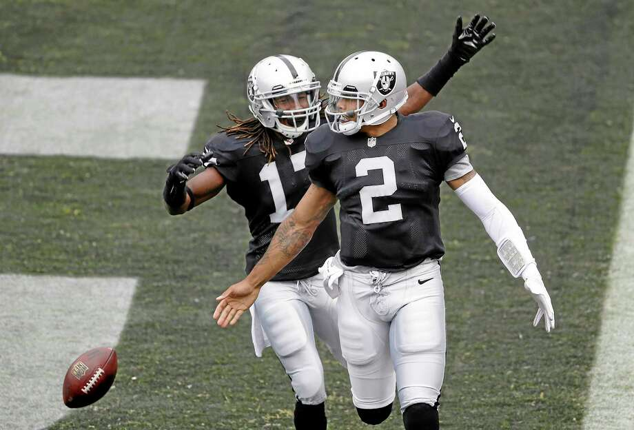 Raiders quarterback Terrelle Pryor (2) celebrates with receiver Denarius Moore after running for a 93-yard touchdown against the Steelers two weeks ago. Photo: Marcio Jose Sanchez — The Associated Press  / AP