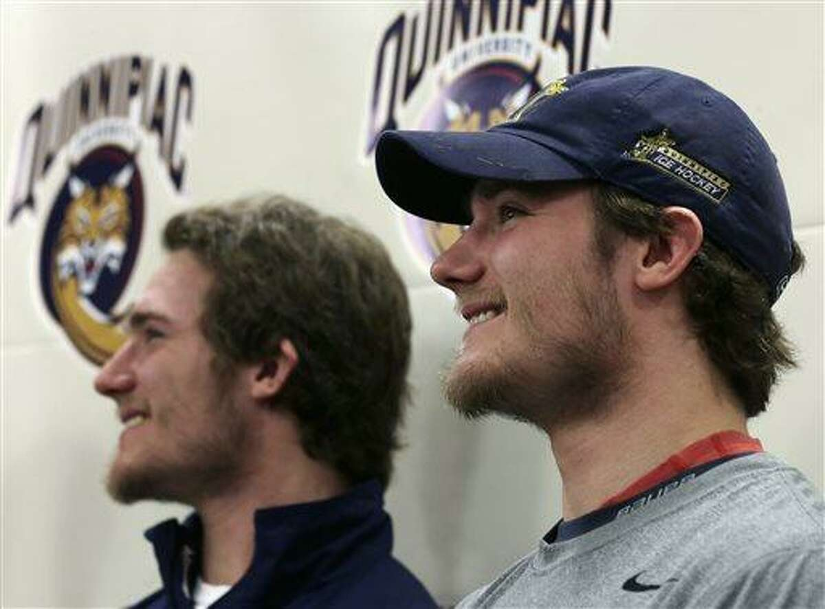 Quinnipiac forward Connor Jones, right, smiles with his twin brother Kellen, who is also a Quinnipiac forward, during a news conference at the university in Hamden, Conn., Tuesday, April 2, 2013. Quinnipiac will face North Dakota in a national semifinal at the NCAA hockey Frozen Four. (AP Photo/Charles Krupa)