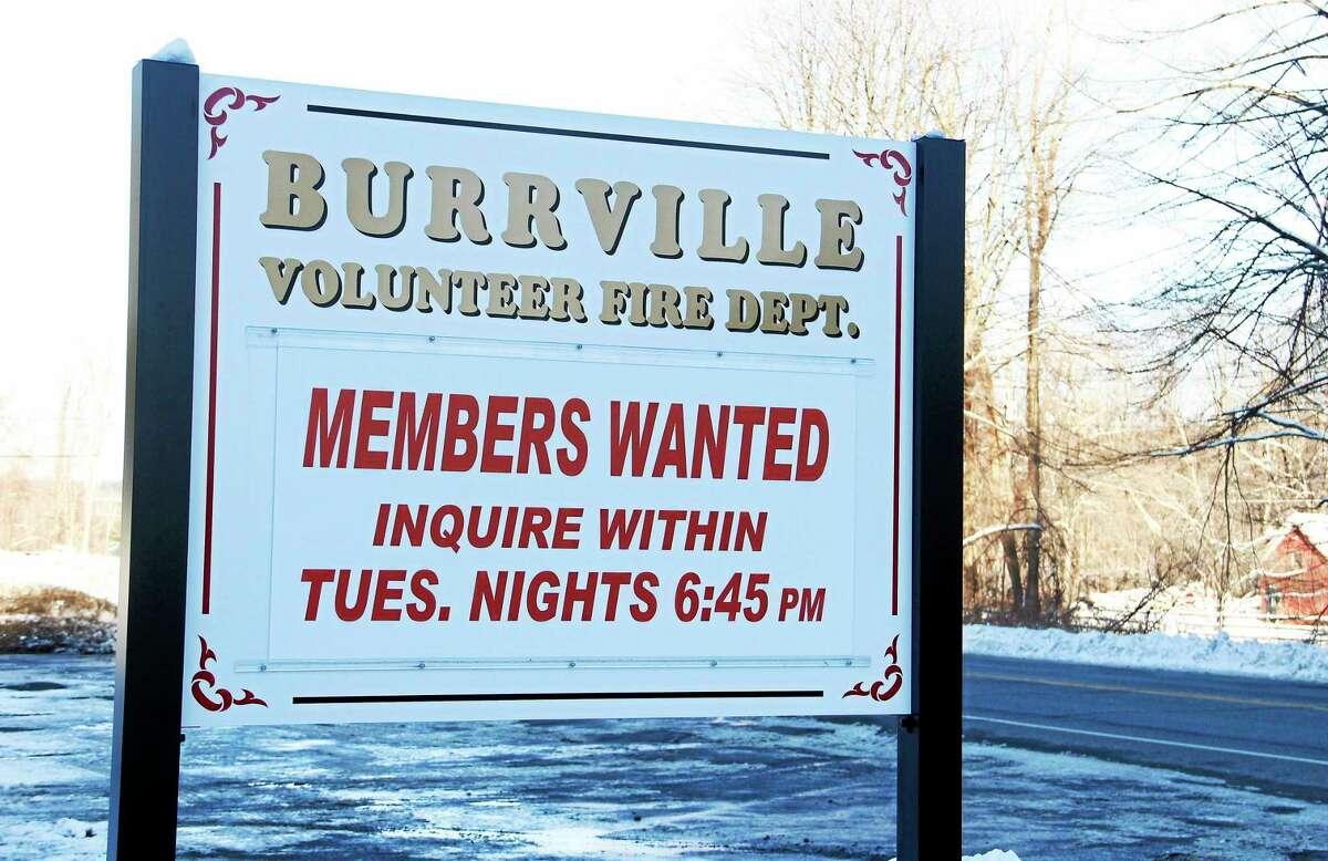 The sign outside the Burville Volunteer Fire Department station encouraging new members to inquire on Thursday, Feb. 6, 2014. The department has been depleted since its board decided to shutdown operations last fall.