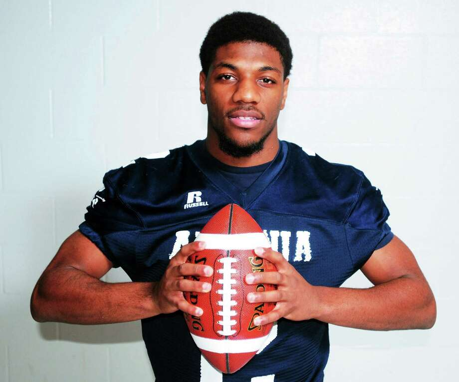 Ansonia star running back Arkeel Newsome signed his national letter of intent to play at UConn on Wednesday. Photo: Arnold Gold - Register