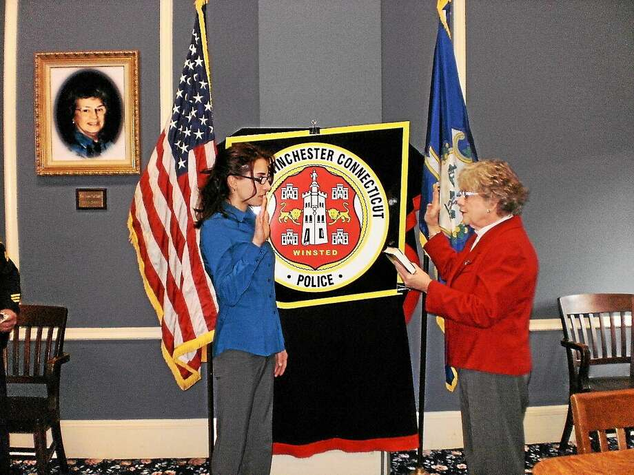 Town clerk Sheila Sedlack (right) swears in new Winchester Police Department officer Jessica Luzefski on Monday. Photo: Contributed Photo