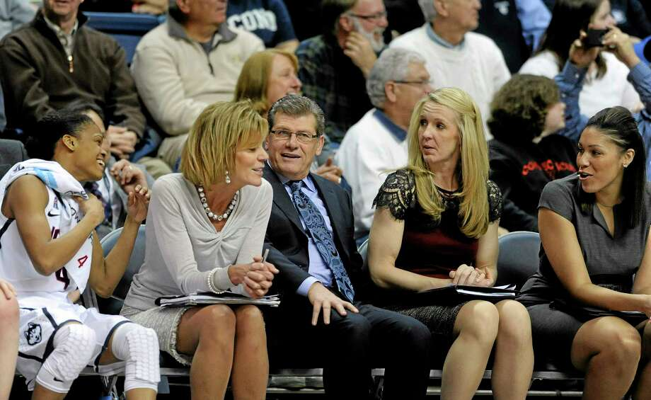 UConn head coach Geno Auriemma shares a light moment with his bench during the second half of the Huskies' 102-41 victory over SMU on Tuesday in Storrs. Photo: Fred Beckham - The Associated Press  / FR153656 AP
