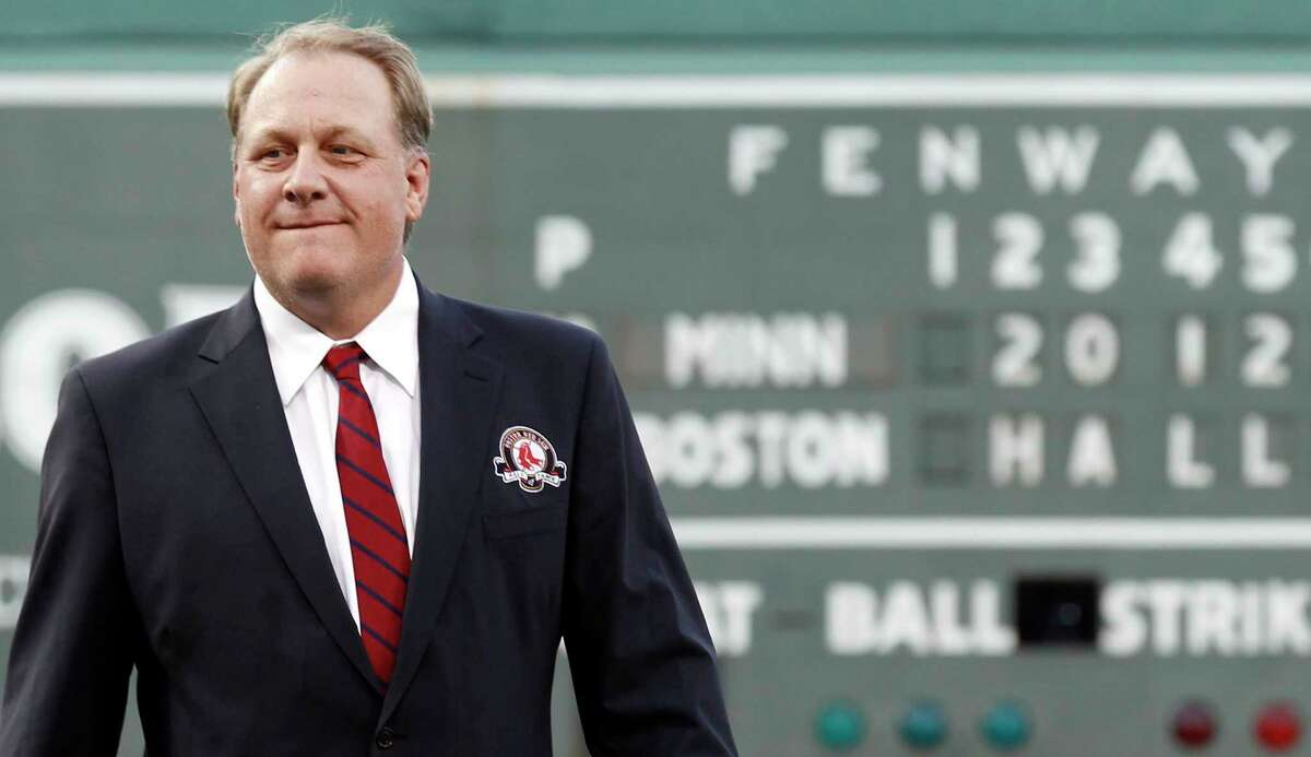 Former star pitcher Curt Schilling looks on after being introduced as a new member of the Boston Red Sox Hall of Fame on Aug. 3, 2012, at Fenway Park. On Wednesday, Schilling announced he was battling cancer.