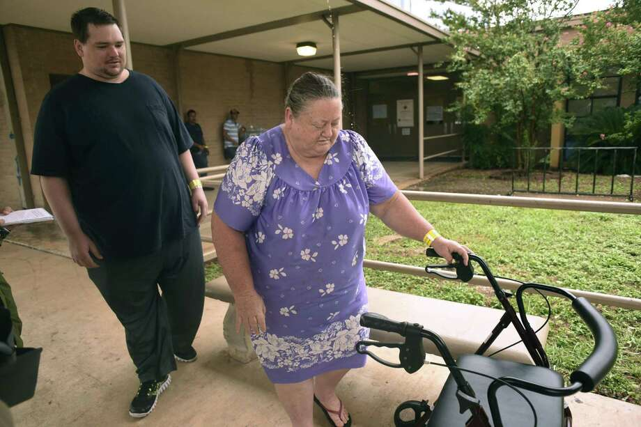 Nancy King, 56, who is from Aransas Pass, and her boyfriend, Jimmy Burdon, 36, who is from Ingleside, are staying at the Kazen Middle School evacuee center on Sunday, Aug. 27, 2017. Nancy King said despite their age difference, they need each other because each as special needs. Photo: Billy Calzada, Staff / San Antonio Express-News / San Antonio Express-News