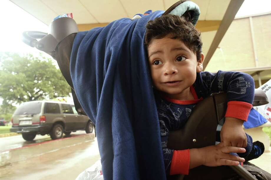 Carlos Rodriguez, who is  22 month old, and his family were evacuated from Robstown to the Kazen Middle School evacuee shelter. Carlos is a special needs child. His mother, Raquel said that the staff at the shelter were providing special foods for Ian. Sunday, Aug. 27, 2017. Photo: Billy Calzada, Staff / San Antonio Express-News / San Antonio Express-News