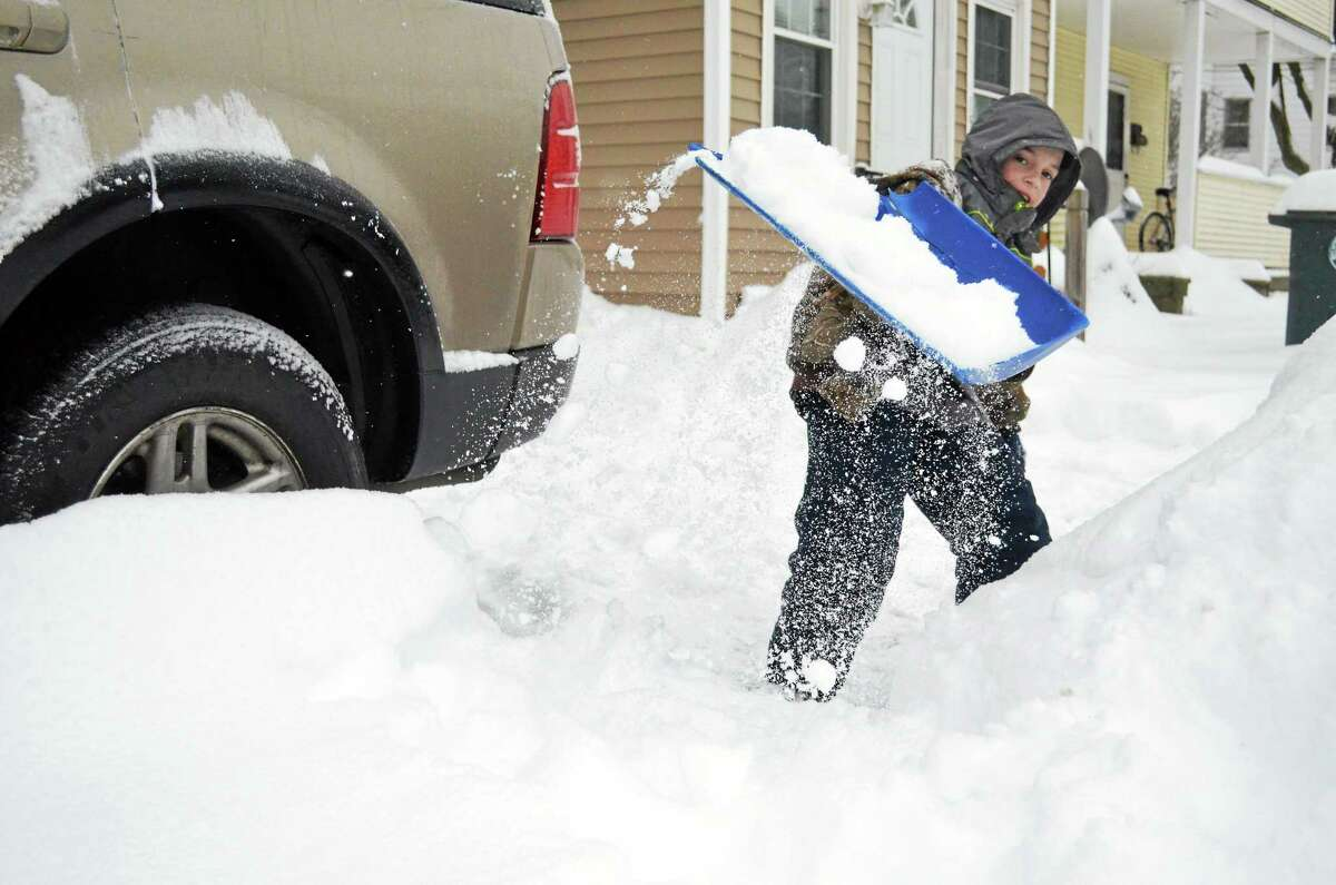 Damian Beland, 9, helps shovel out from Wednesday morning's storm at his home on Park Ave in Torrington. See additional photos on A3 or online at media.RegisterCitizen.com