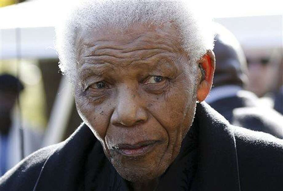 In this June 17, 2010 file photo, former South African President Nelson Mandela leaves the chapel after attending the funeral of his great-granddaughter Zenani Mandela in Johannesburg, South Africa. The South African presidency says Mandela has been discharged, Saturday, April 6, 2013, from a hospital after an improvement in his condition. Officials say he was treated for pneumonia. (AP Photo/Siphiwe Sibeko, Pool, File) Photo: AP / Pool Reuters