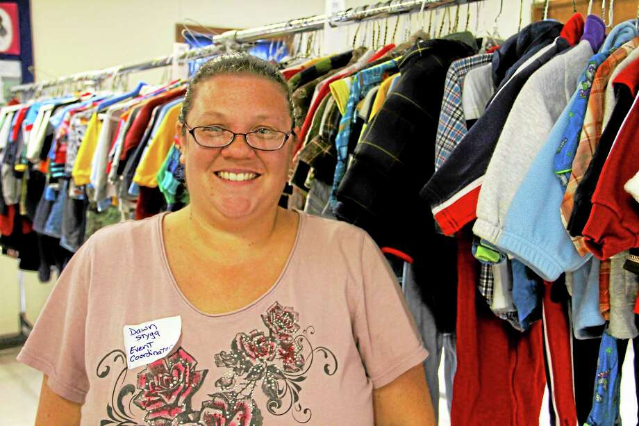 Dawn Styga stands near a rack of children's clothing during a consignment sale on Saturday, Nov. 9, 2013. She served as event organizer of the Tots Treasure Consignment Sale, which had its second day of selling children's items, women's purses, holiday decor and other items at United Congregational Church on Torringford Street on Saturday. Photo: Esteban L. Hernandez—Register Citizen