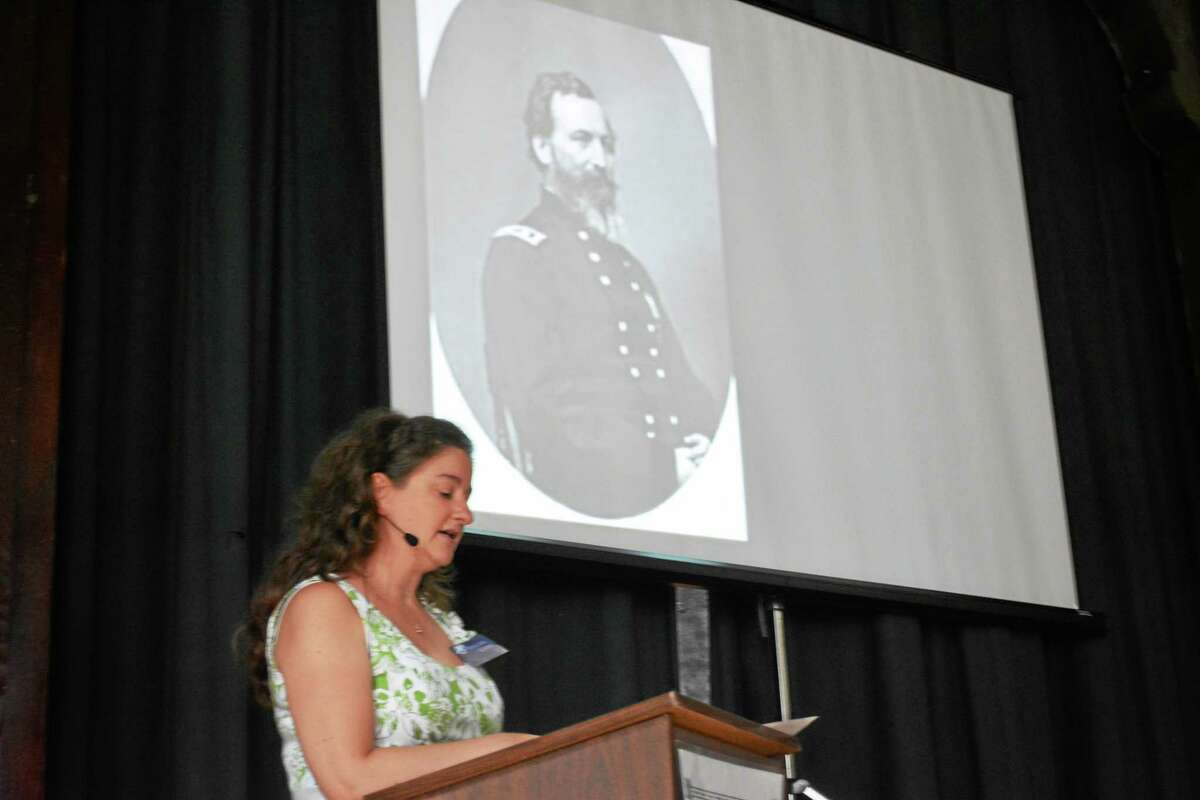 Ryan Flynn - Register Citizen Raechel Guest speaks to the crowd while the projector displays an image of famous general John Sedgwick, a Cornwall native.