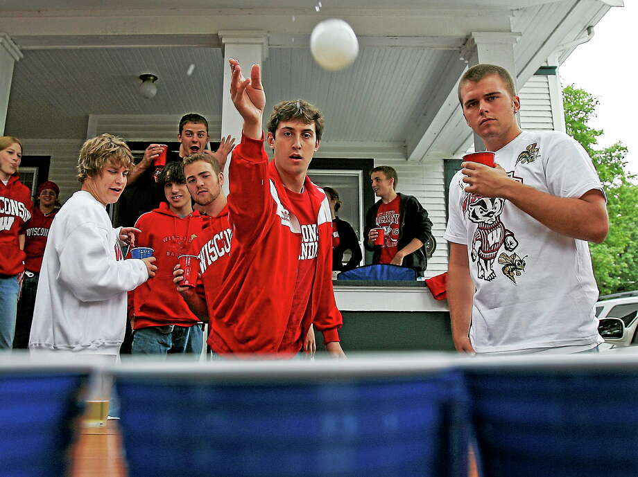 A demonstration of the drinking game: Tim Schmock, of Madison, Wis., plays beer pong before a football game between Wisconsin and Western Illinois Saturday, Sept. 9, 2006, in Madison, Wis. Photo: AP Photo/Morry Gash  / AP2006