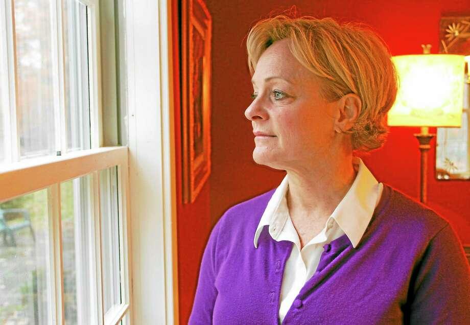 Elinor Carbone stands near a window in her home in Torrington. Photo: Esteban L. Hernandez — Register Citizen
