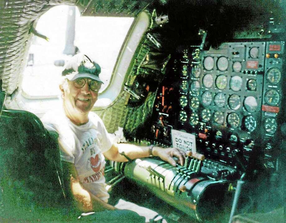 Korean War veteran Vinnie Basile sits aboard a B29 bomber at Oxford Airport in 1995 in what was once his station when he served on similar bombers during wartime. Photo: Contributed Photo
