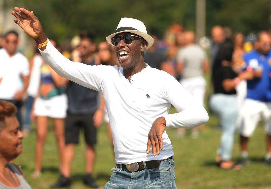 Mouricio Santos, of Bridgeport, dances to the music at the 5th Brazilian Day Festival at Seaside Park in Bridgeport, Conn. on Sunday, August 27, 2017. The event featured live bands, Zumba, and a variety of traditional fodd and drink. Photo: Brian A. Pounds / Hearst Connecticut Media / Connecticut Post