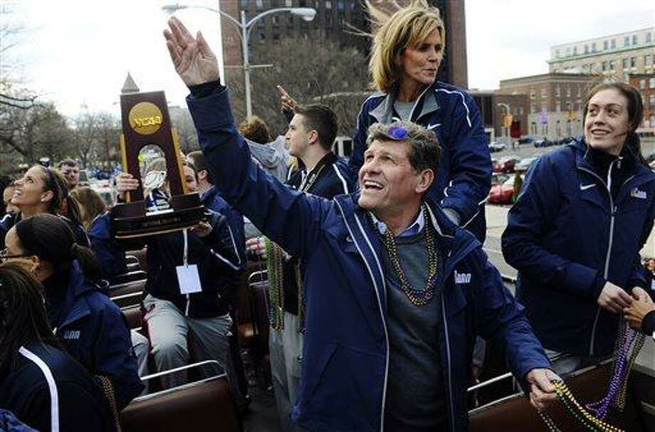 Connecticut head coach Geno Auriemma throws beads as Breanna Stewart, right, watches during a parade celebrating the women's basketball team's national championship victory in the NCAA college tournament in Hartford, Conn., Sunday, April 14, 2013. (AP Photo/Jessica Hill) Photo: AP / FR125654 AP