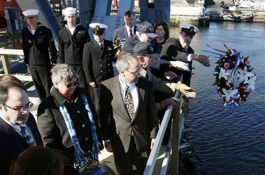 Family, veterans and current service members take part in a wreath ceremony to mark the 50th anniversary of the sinking of the USS Thresher, Saturday, April 6, 2013, on Memorial Bridge in Portsmouth, N.H. (AP Photo/Michael Dwyer) Photo: AP / AP