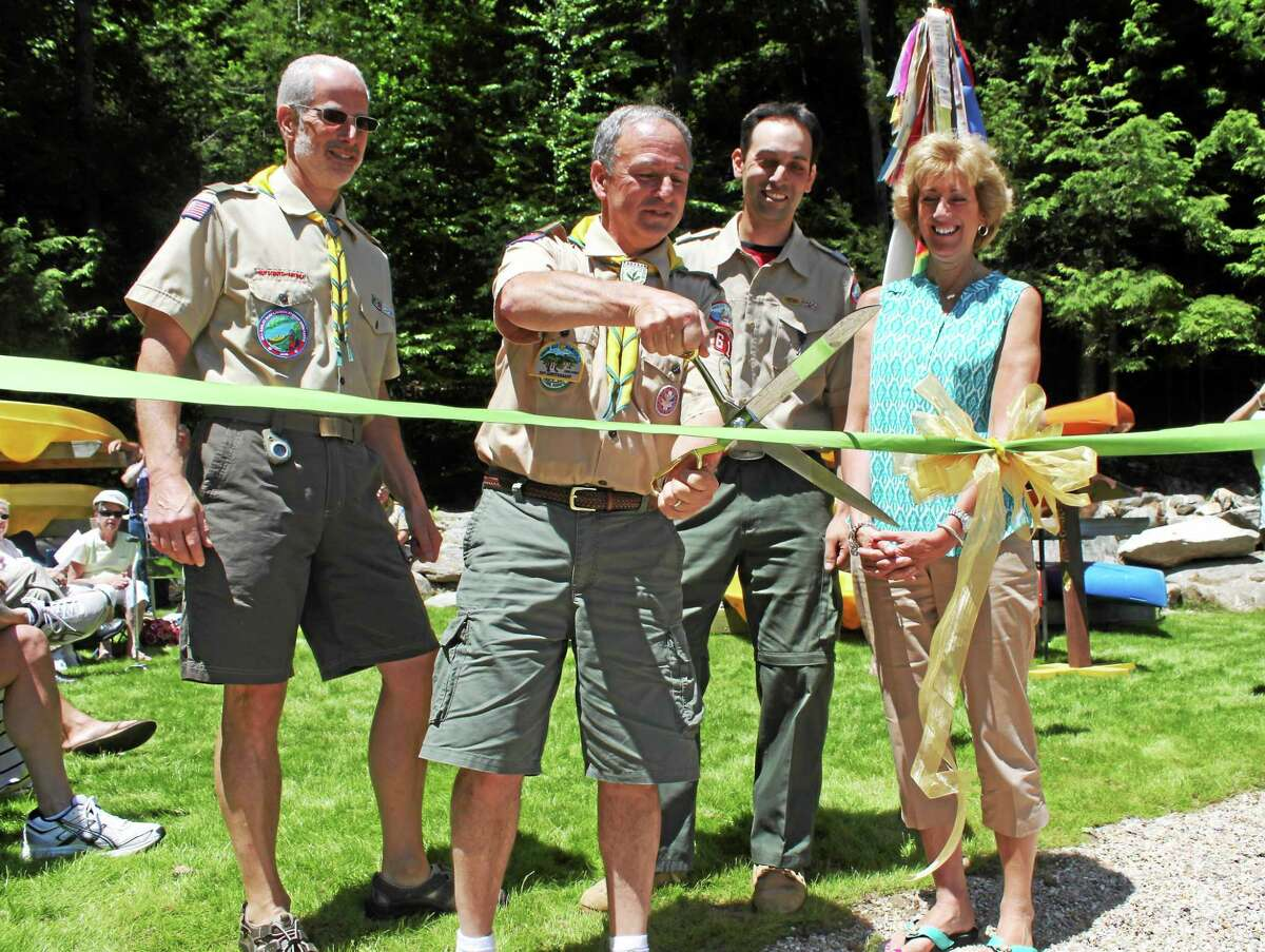 At the ribbon cutting ceremony, from left, are: Troop 610 Assistant Scoutmaster Jim Earley, Troop 610 Scoutmaster Bill Earley, Camp Sequassen Ranger Dave Boyajian, Claudia Earley (Scoutmaster's wife).