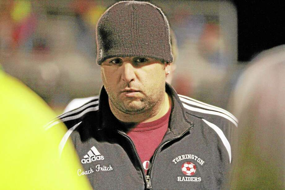 Coach Mike Fritch of Torrington after the first of two overtime periods.  Pomperaug came back from a 2-0 deficit to defeat Torrington 3-2 in overtime. Photo: Marianne Killackey — Special To Register Citizen  / 2013