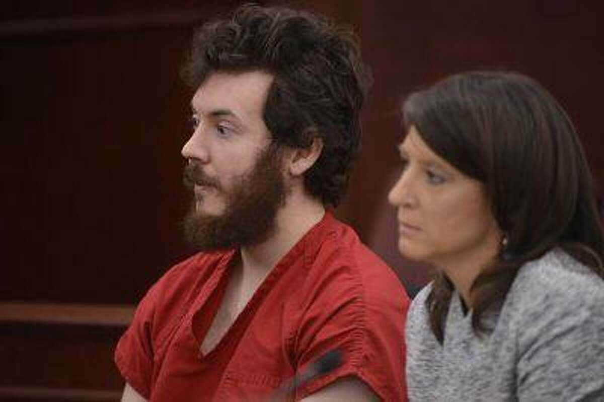 James Holmes, the suspect in the Aurora movie theater massacre, appears in court on March 12, 2013.