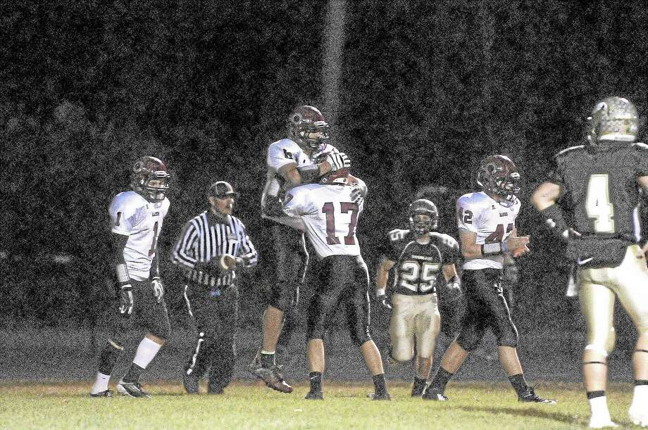 Torrington's Desmond Langs celebrates his 20-yard touchdown catch with Nate Manchester. The touchdown cut the Red Raiders deficit to six in the first quarter. Torrington lost the game 46-14 to Woodland. Photo: Laurie Gaboardi — Register Citizen