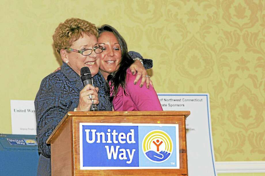 JoAnn Ryan embraces Angela DiMauro at the United Way's celebration at P. Sam's in Torrington Thursday night. The event was the finale of the charity's annual campaign.Laurie Gaboardi - Register Citizen Photo: Journal Register Co.