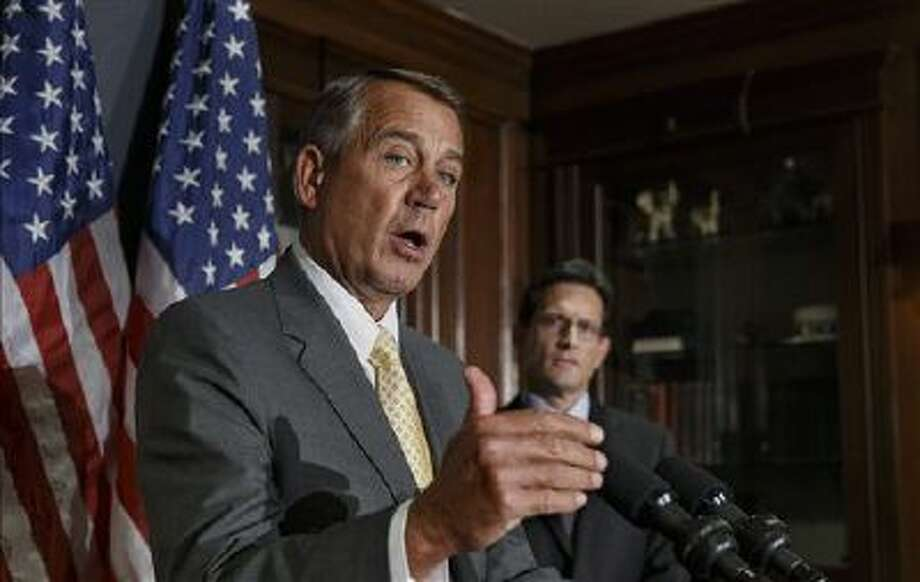 House Speaker John Boehner of Ohio, left, with House Majority Leader Eric Cantor of Va., talks with reporters at Republican National Committee headquarters in Washington on Jan. 28 after a GOP strategy session. Photo: AP / AP