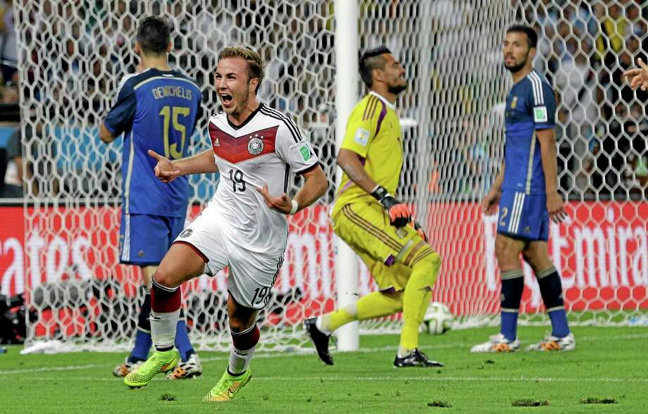 Germany's Mario Goetze celebrates after scoring past Argentina's goalkeeper Sergio Romero during the World Cup final on Sunday. Photo: Victor R. Caivano — The Associated Press  / AP