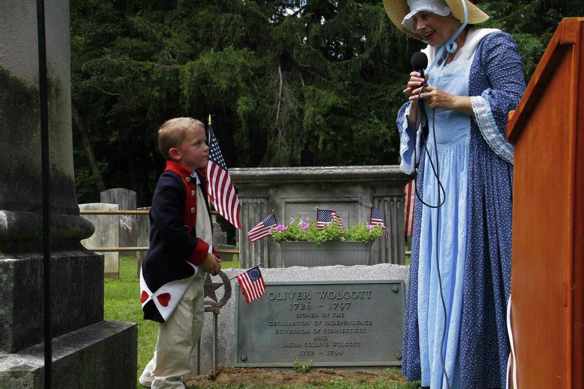 Judy Buckbee of the Daughters of the American Revolution with Jackson Delmore, 5. (Esteban L. Hernandez - Register Citizen)