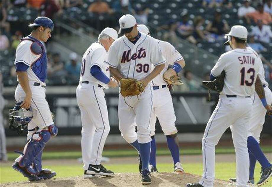 New York Mets relief pitcher David Aardsma (30) leaves a baseball game after walking in a run during the 13th inning against the Arizona Diamondbacks, Thursday, July 4, 2013, in New York. (AP Photo/Frank Franklin II) Photo: AP / AP