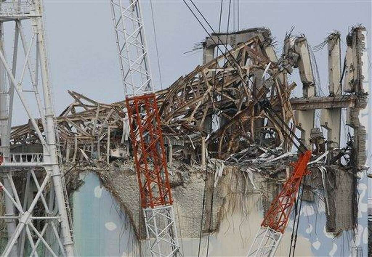 AP FILE - In this Feb. 20, 2012 file photo, damaged Unit 3 reactor building of Tokyo Electric Power Co.'s tsunami-crippled Fukushima Dai-ichi nuclear power plant is seen in Fukushima prefecture, northeastern Japan. The cooling system failed for a storage pool for fuel at one of the reactors at the tsunami-damaged nuclear plant in northeastern Japan Friday, April 5, 2013 - the second in a month, although there was no immediate danger from the breakdown. Nuclear Regulation Authority spokesman Takahiro Sakuma said an alarm went off in the afternoon about the problem at reactor No. 3. The cause was still under investigation. (AP Photo/Issei Kato, File)