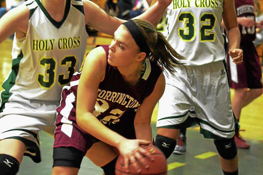 Torrington's Taylor Howe looks for a open teammate to pass to during the Red Raiders 50-41 loss to Holy Cross. Howe scored three points in the loss. Photo: Pete Paguaga — Register Citizen