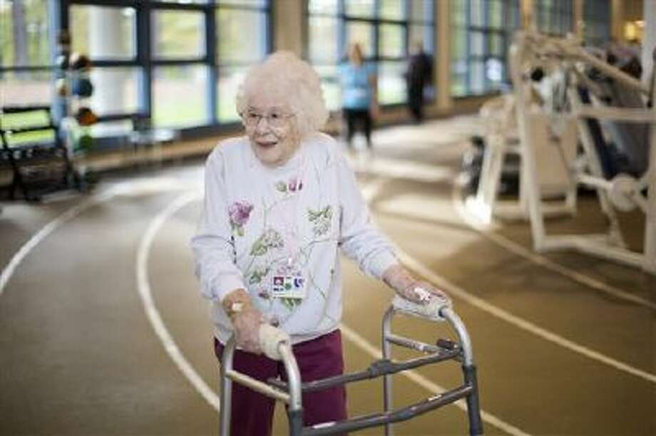 """100-year-old Mary """"May"""" Segal walks the track at the Duke Center for Living in Durham, N.C. Segal began attending the fitness center 35 years ago and was presented with a lifetime free membership for her birthday. When asked by a bystander what the key to longevity was Segal said, """"Put Texas Pete on everything, just not your cake."""" Photo: AP / The News & Observer"""