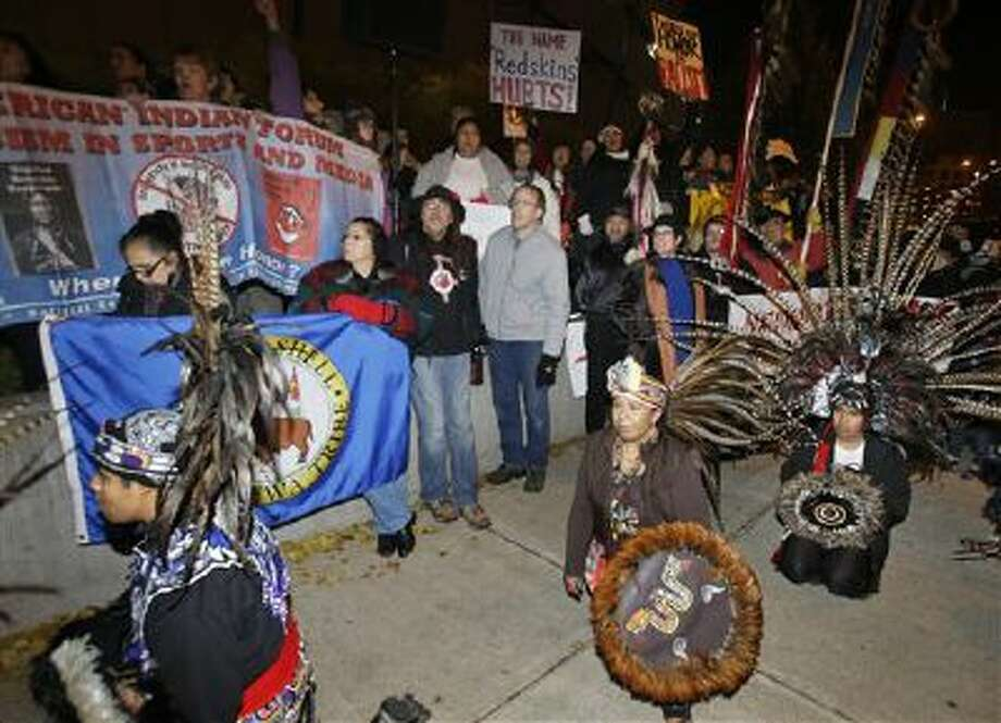American Indians and their supporters gather outside the Metrodome to protest the Washington Redskins' name, prior to an NFL football game between the Redskins and the Minnesota Vikings, Thursday, Nov. 7, 2013, in Minneapolis. Photo: AP / AP