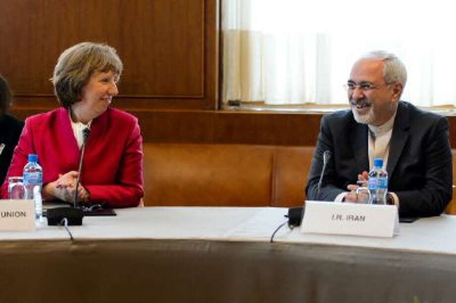 EU foreign policy chief Catherine Ashton, left, speaks with Iranian Foreign Minister Mohammad Javad Zarif on November 7, 2013 before the start of two days of closed-door nuclear talks in Geneva. Photo: AFP/Getty Images / 2013 AFP