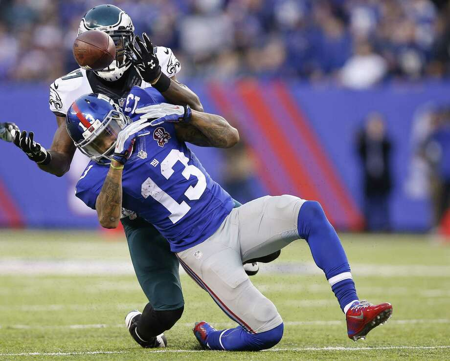 The Eagles' Malcolm Jenkins (27) breaks up a pass to the Giants' Odell Beckham (13) during the second half Sunday. Photo: Kathy Willens — The Associated Press  / AP