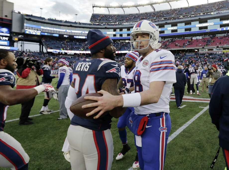 Patriots cornerback Darrelle Revis (24) and Bills quarterback Kyle Orton (18) speak at midfield after Sunday's game. Photo: Charles Krupa — The Associated Press  / AP
