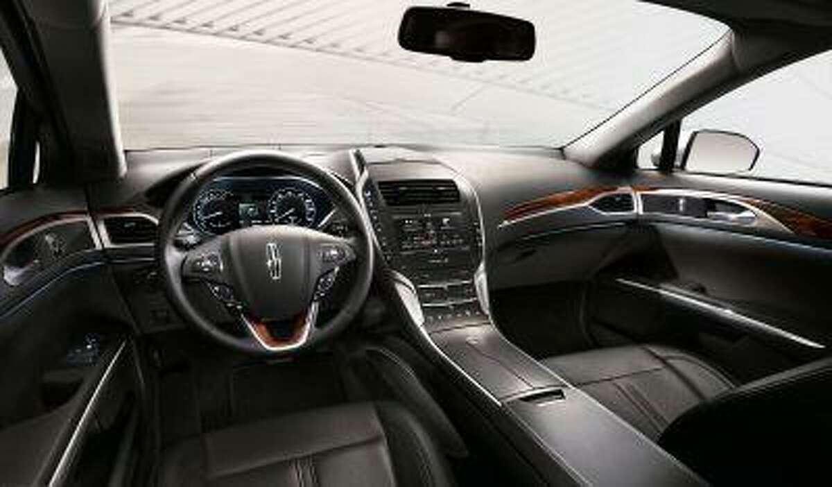 2013 Lincoln MKZ: Design teams created an approachable exterior that invites drivers inside to an airy and warm environment composed of bold architectural elements, rich natural materials and many fine details in the 2013 Lincoln MKZ.