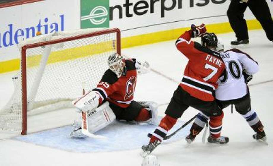 Avalanche forward Ryan O'Reilly scores the game-winning goal against the New Jersey Devils.