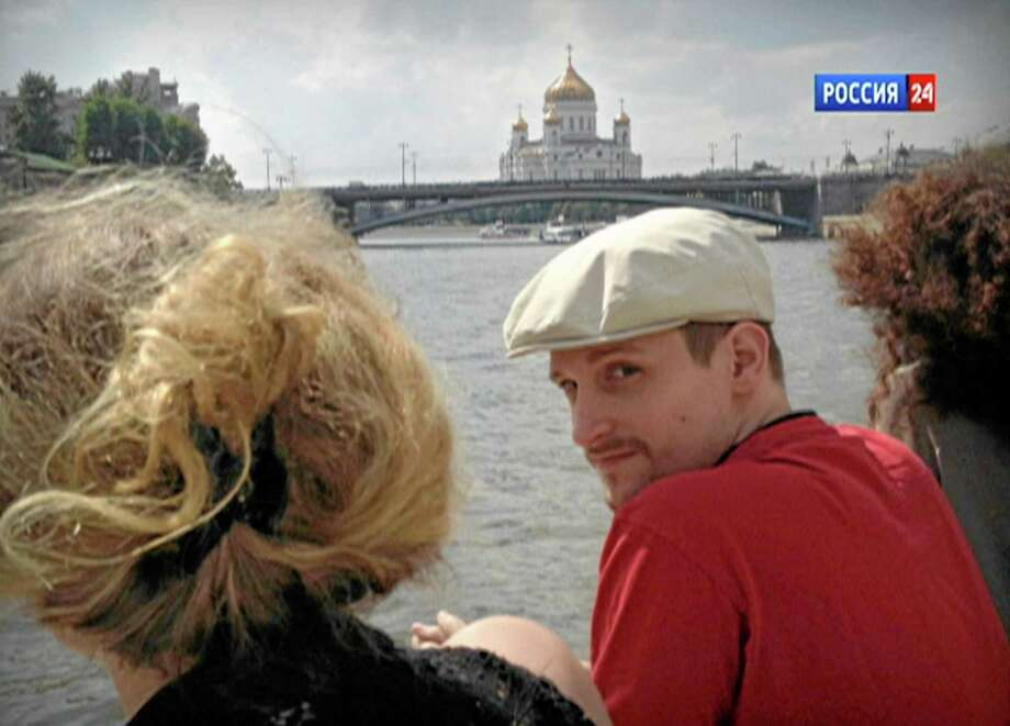 In this video frame grab provided by LifeNews via Rossia 24 TV channel, which has been authenticated based on its contents and other AP reporting, former National Security Agency systems analyst Edward Snowden looks over his shoulder during a boat trip on the Moscow River in Moscow, with the Christ the Savior Cathedral in the background. LifeNews said the video was shot in September 2013 and Snowden's lawyer, Anatoly Kucherena, confirmed the photo's authenticity. Snowden is calling for international help to persuade the U.S. to drop its espionage charges against him, according to a letter a German lawmaker released Friday after he met the American in Moscow. (AP Photo/LifeNews via Rossia 24 TV channel)   TV OUT Photo: AP / LifeNews via Rossia 24 TV channel