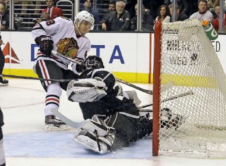 Patrick Kane scores on Kings goalie Jonathan Quick in the Blackhawks' 5-3 win.