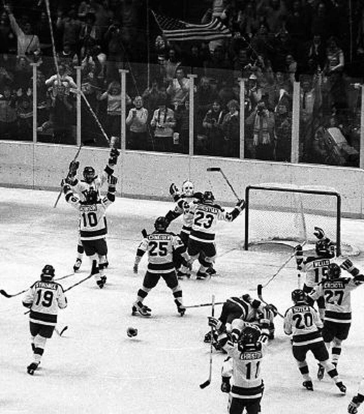 The U.S. men's ice hockey team celebrates winning beating the Soviet Union in the
