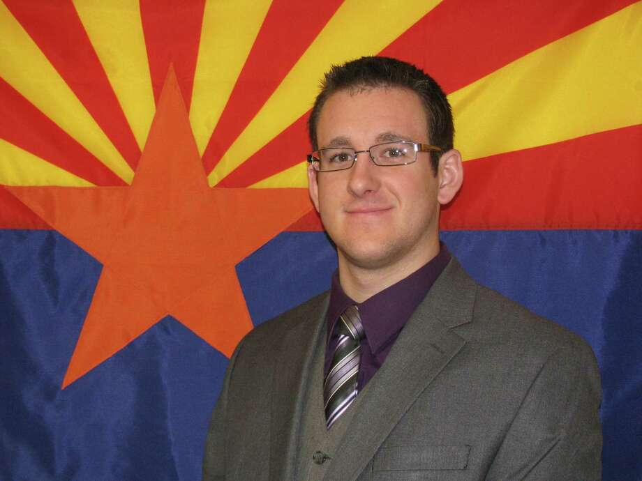 This Nov. 27, 2008 photo released by the Flagstaff Police Department, shows police officer Tyler Stewart, 24, who died Saturday, Dec. 27, 2014 at Flagstaff Medical Center after he was shot by a suspect in a domestic-violence case, police said. Photo: AP Photo/Flagstaff Police Department  / Flagstaff Police Department