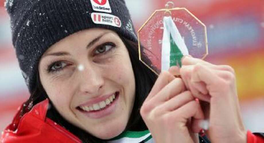 Janine Flock of Austria poses with her gold medal during the European Champion victory ceremony at the women's Skeleton World Cup race in Koenigssee, southern Germany, on Friday, Jan. 24, 2014.