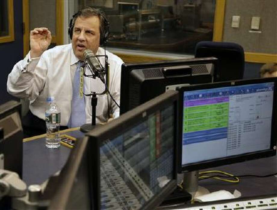 "New Jersey Gov. Chris Christie sits in a studio Monday during his radio program, ""Ask the Governor"" broadcast in Ewing, N.J. Photo: AP / Pool, AP"