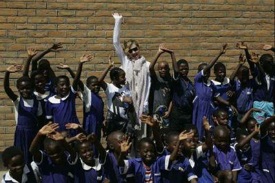 Madonna and her children David, to her left, and Mercy, to her right, visited Mkoko Primary School, one of the schools her Raising Malawi organization has built jointly with U.S. organization BuildOn, on April 2, 2013.