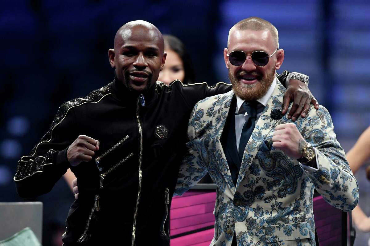 Floyd Mayweather Jr. and Conor McGregor went from ring rivals to friendly foes after their super welterweight bout on Saturday night. Mayweather won when the fight was stopped in the 10th round.