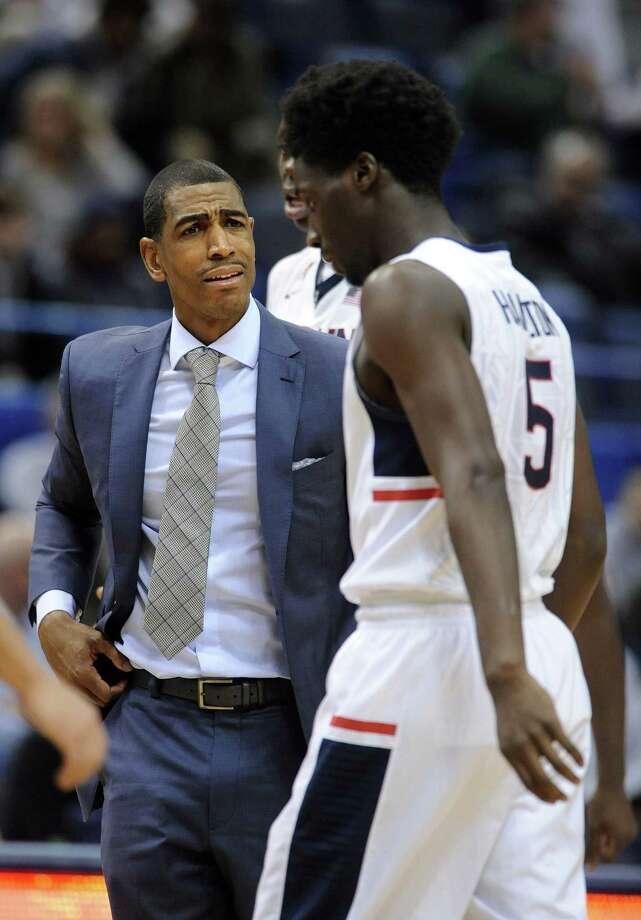 Connecticut head coach Kevin Ollie speaks with Daniel Hamilton (5) during the first half of an NCAA college basketball game in Hartford, Conn., on Sunday, Dec. 14, 2014. Connecticut won the game 106-85.(AP Photo/Fred Beckham) Photo: AP / FR153656 AP