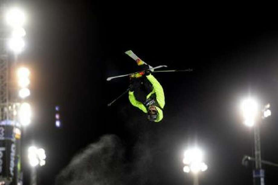 Don't try this at home: Kevin Rolland soars upside down in ski halfpipe competition during the Winter X Games in Aspen last month.