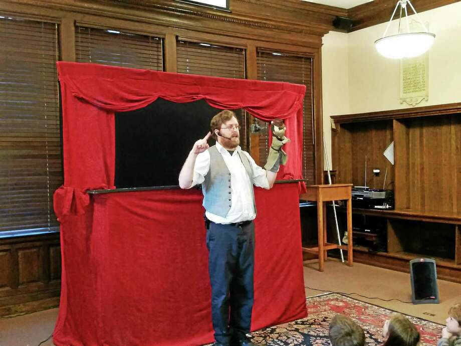 Photos by N.F. Ambery Vernon-based Lionheart Puppet Company puppeteer Matthew K. Leonard is shown with his puppets prior to his original show ìJack Tuesday ñ Fair Tale Investigatorî at the Gunn Memorial Library at 5 Wykeham Road in Washington on Saturday afternoon. Photo: Journal Register Co.