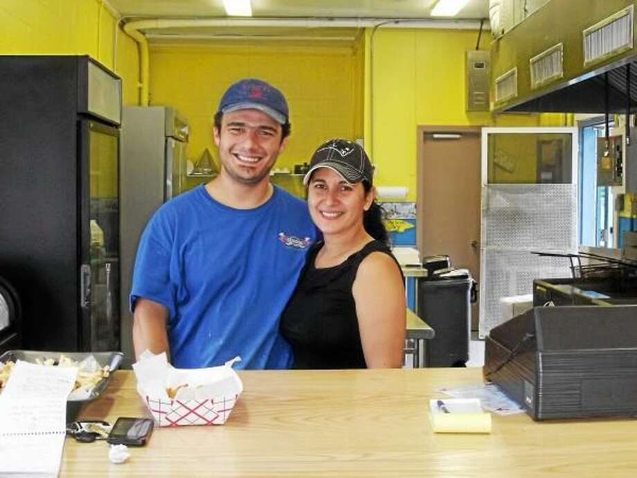 Owners Jayson Northrop and Idalmis Calderon behind the counter at their restaurant. (Jenny Golfin-Register Citizen)